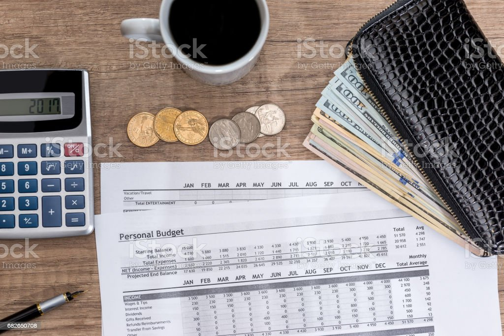 finance report with usa dolalr, calculator and pen on desk. stock photo