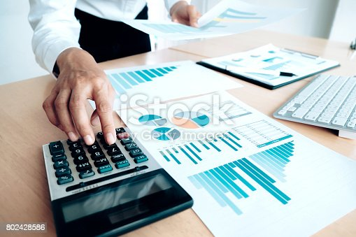 954578184 istock photo Finances Saving Economy concept. Female accountant or banker use calculator. 802428586