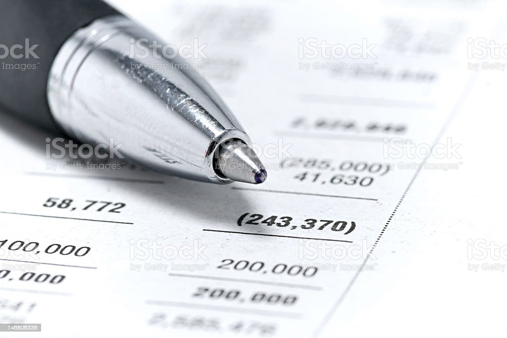 Finances statement with Pen stock photo