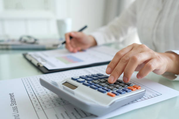financial accounting auditing financial advisor calculating and analyzing for performance business assessment. financial and accounting concept. accounting ledger stock pictures, royalty-free photos & images