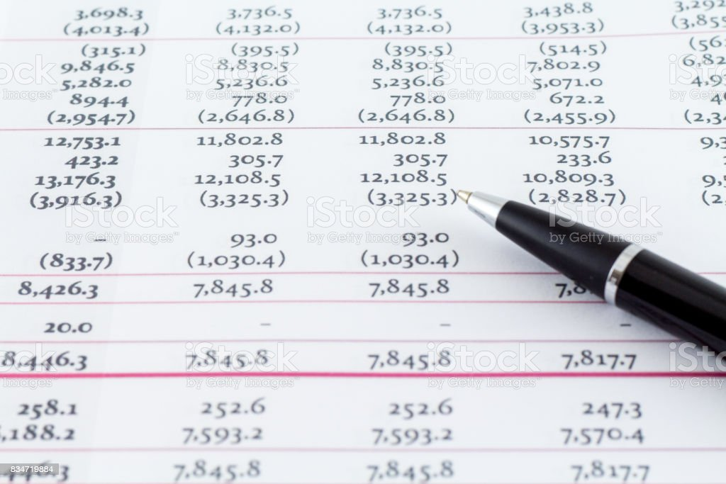 Financial Accounting Sheet With Black Writing Pen stock photo