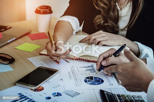 950986656istockphoto Financial advisor, accounting and Investment concept, business owners consult adviser financial meeting to analyze and  on the finance report in the his office room. 953533880