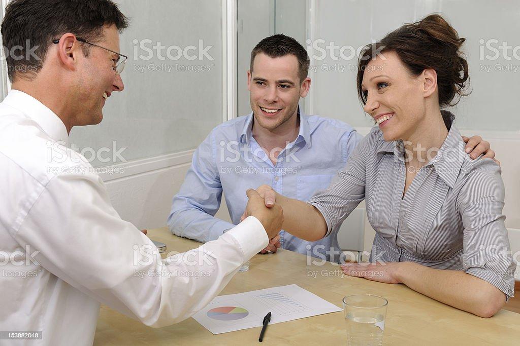 Financial advisor and happy couple stock photo