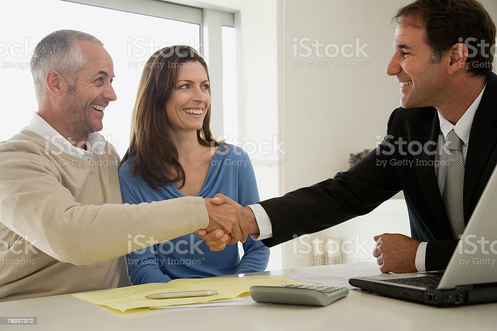 Financial advisor and man shaking hands royalty-free 스톡 사진