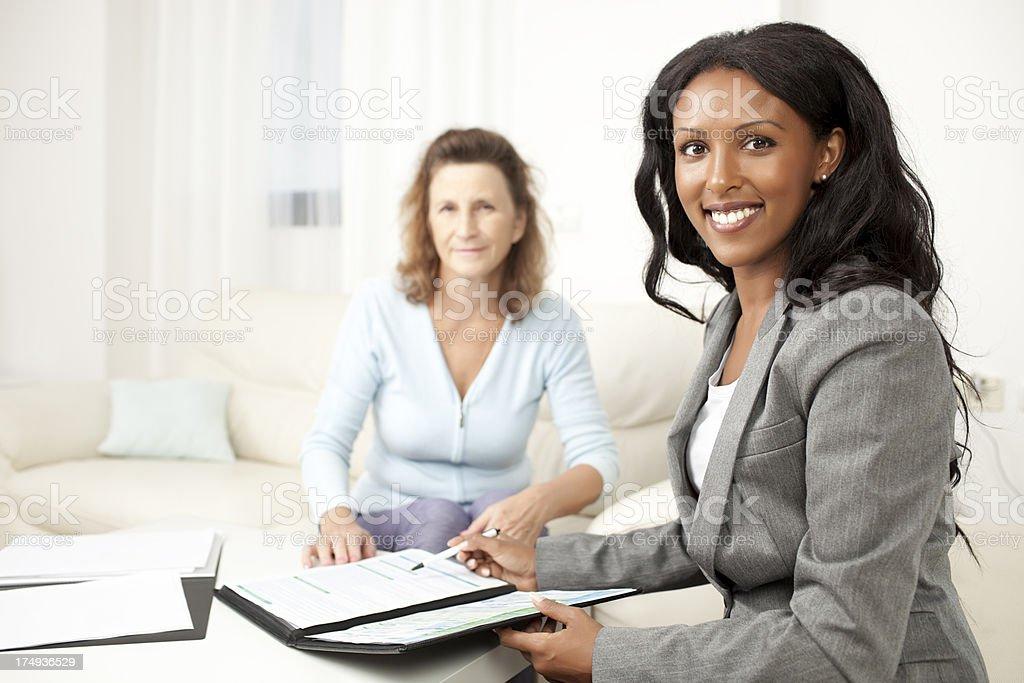 Financial advisor at home. stock photo