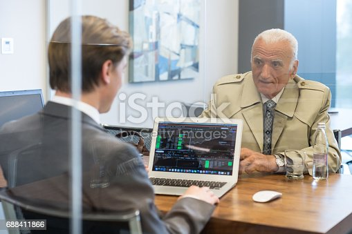625740042 istock photo Financial advisor consulting senior client with his investment strategy. 688411866