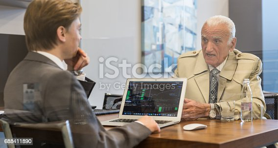 625740042 istock photo Financial advisor consulting senior client with his investment strategy. 688411890