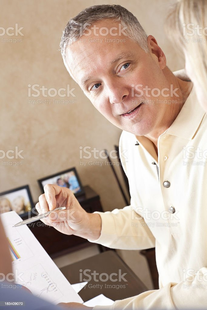 Financial Advisor Discussing Finances With Couple At Their Home royalty-free stock photo