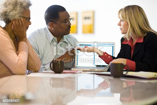 istock Financial Advisor Discussing Investment Plan With Couple 525563401