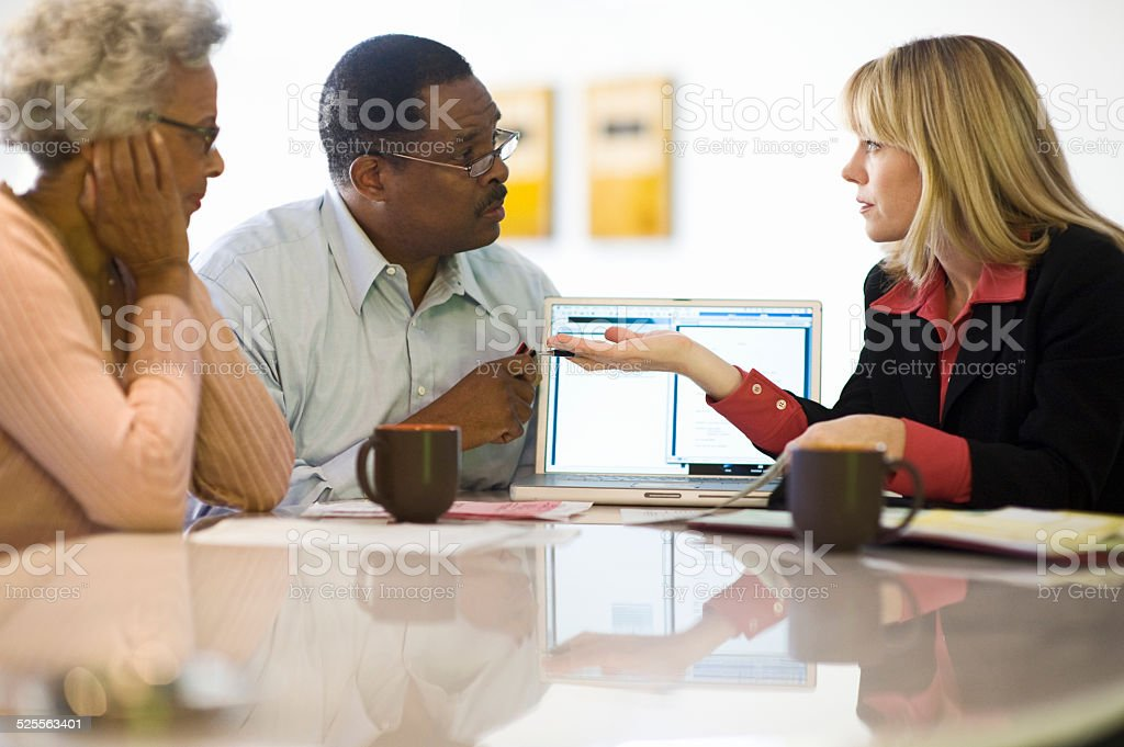 Financial Advisor Discussing Investment Plan With Couple stock photo