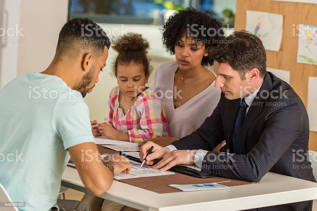 Financial advisor discussing with his clients stock photo