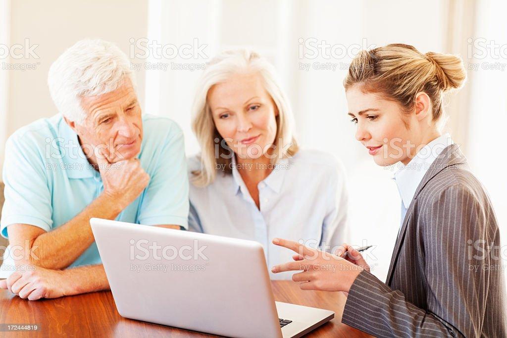 Financial Advisor Explaining An Investment Plan To Couple stock photo