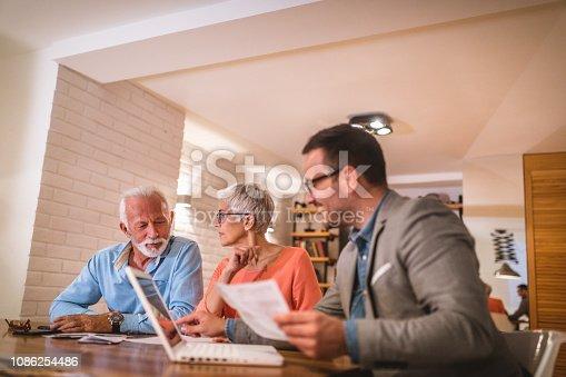 Young financial advisor helping a senior couple