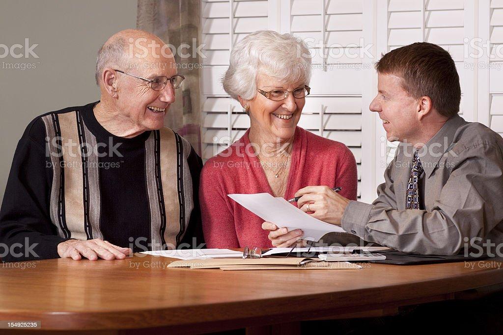 Financial Advisor making plans with Senior Couple stock photo