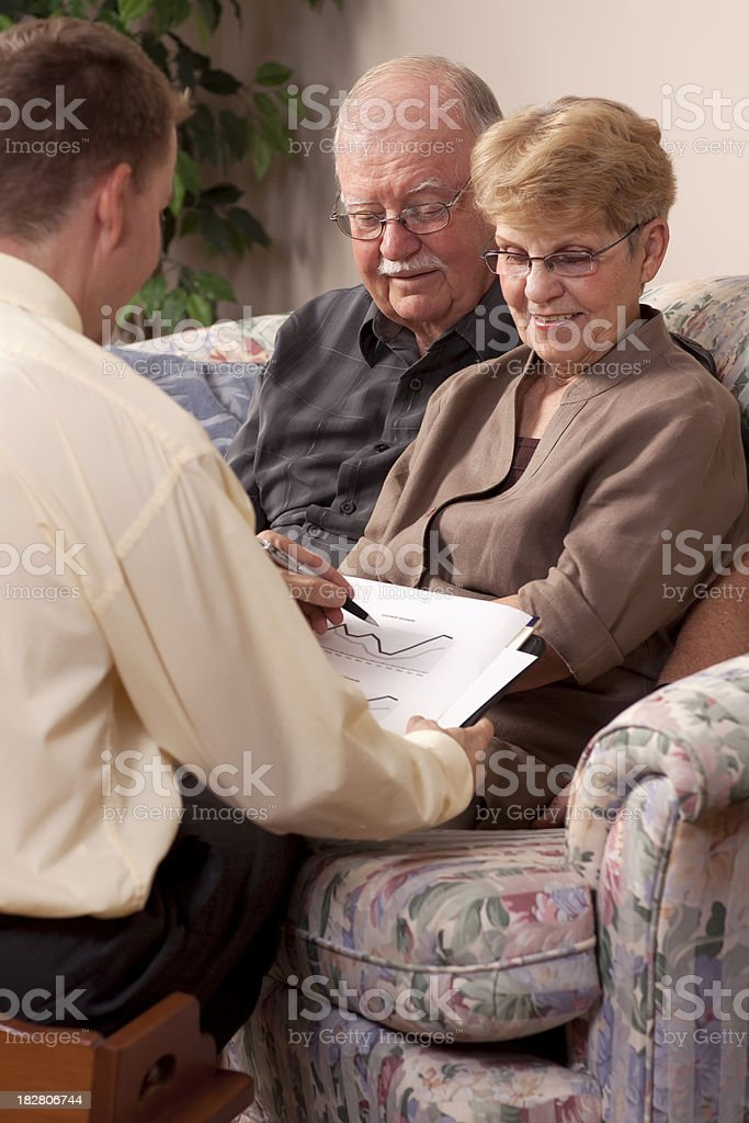 Financial Advisor making plans with Senior Couple stock photo