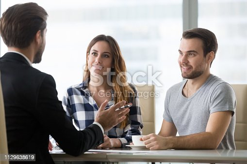 994164754istockphoto Financial advisor making presentation offer to clients at meeting 1129638619