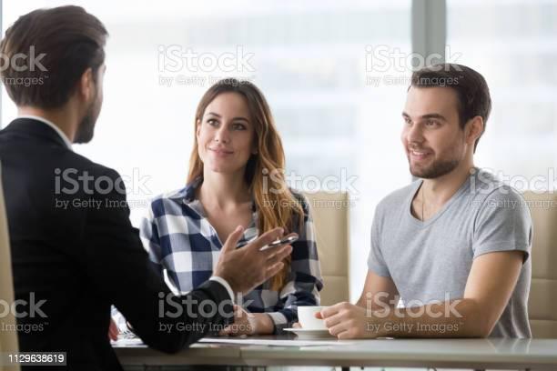 Financial advisor making presentation offer to clients at meeting picture id1129638619?b=1&k=6&m=1129638619&s=612x612&h=hxnkmxahacwk 9phucbvkqk986mpuyxrprmpiq0z0uq=
