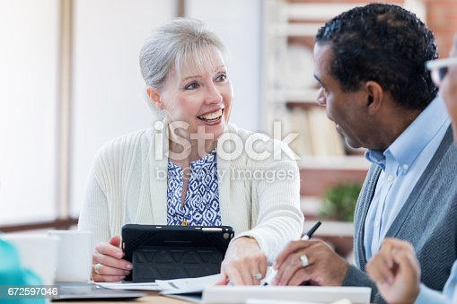 487670635istockphoto Financial advisor meets with senior client 672597046