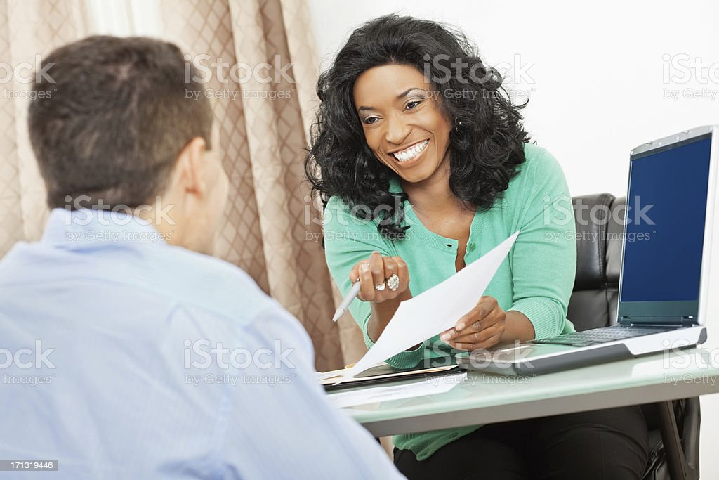 Financial advisor or colleague in office laughing with man stock photo