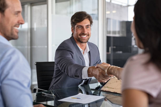 Financial advisor shaking hand to seal a deal stock photo