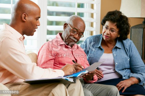 istock Financial Advisor Talking To Senior Couple At Home 177733410