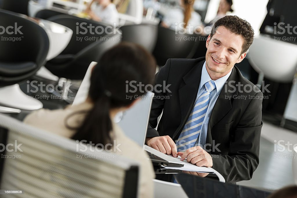 Financial Advisor Talking With His Client stock photo