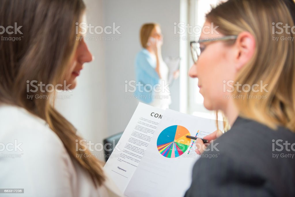 Financial advisor with a client looking at report royalty-free stock photo