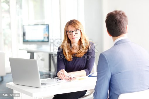 546183298 istock photo Financial advisor with client 546183246