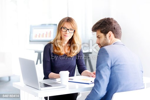 546183298 istock photo Financial advisor with client 546183414