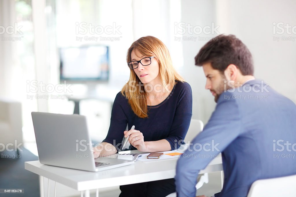 Financial advisor with client stock photo