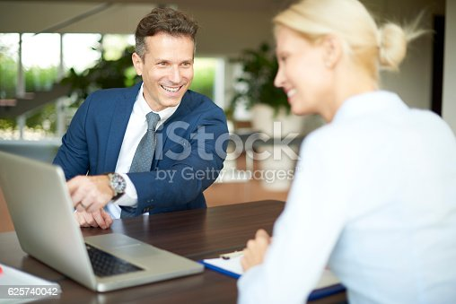 istock Financial advisor with client 625740042