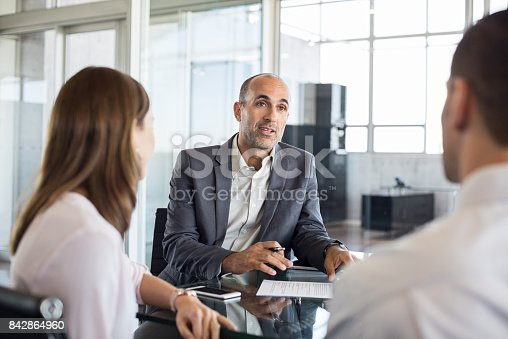 istock Financial advisor with clients 842864960