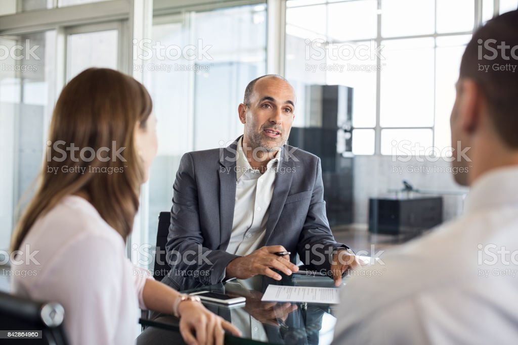 Financial advisor with clients stock photo