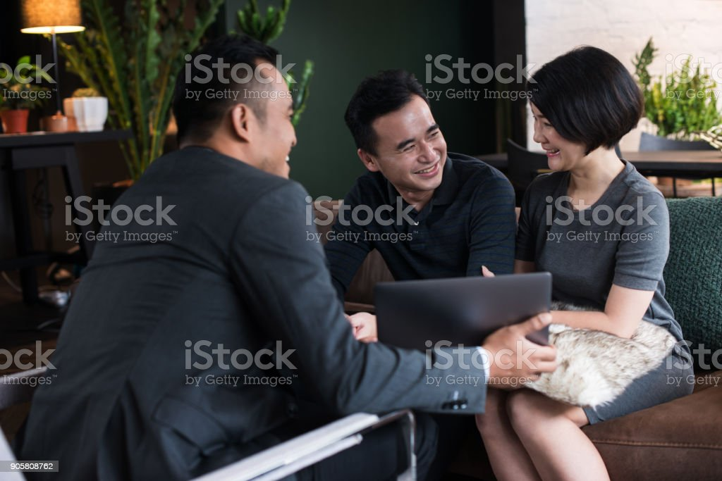 Financial advisor with clients. stock photo