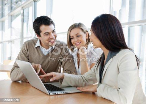 istock Financial Advisor With Couple 155391676