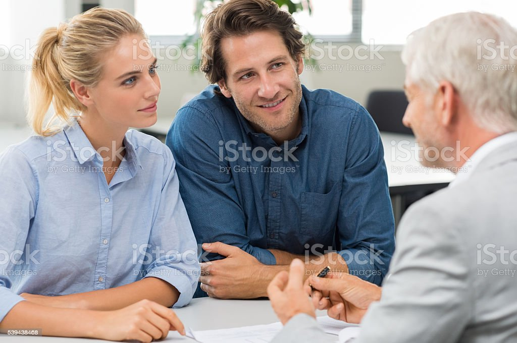 Financial advisor with customer stock photo