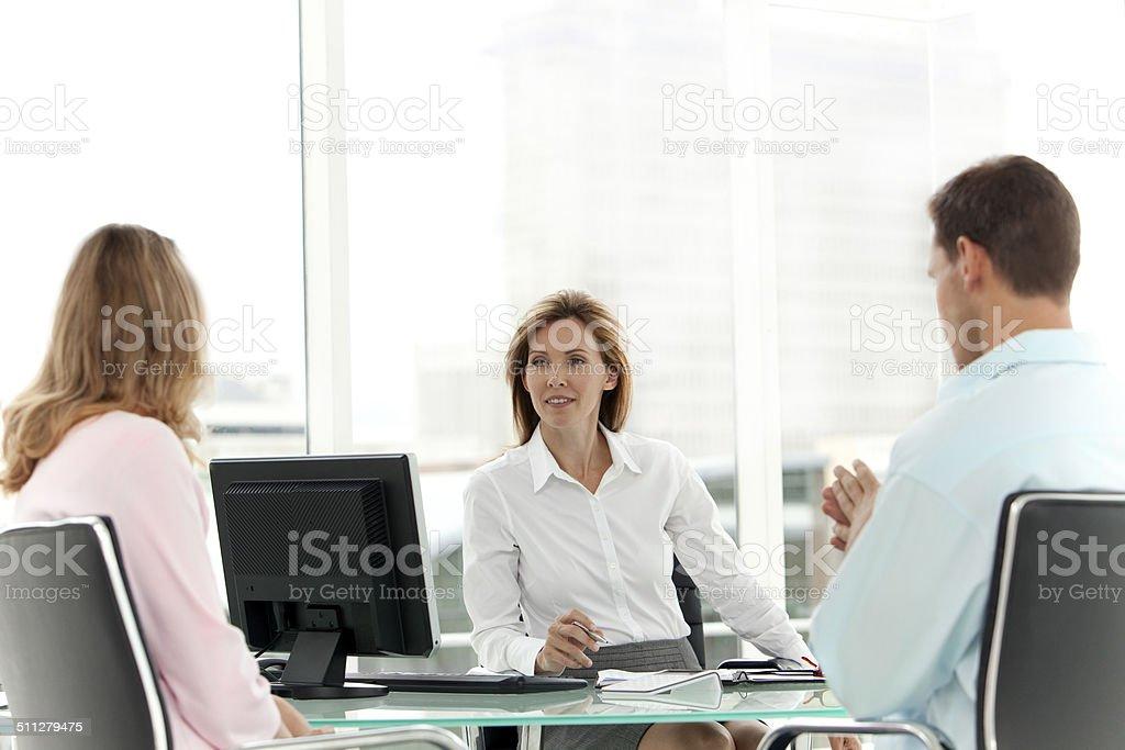 Financial Advisor with customers stock photo