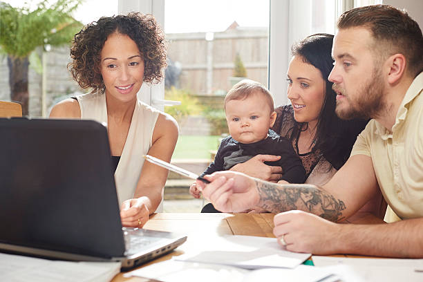 financial advisor with young family - four lawyers stockfoto's en -beelden