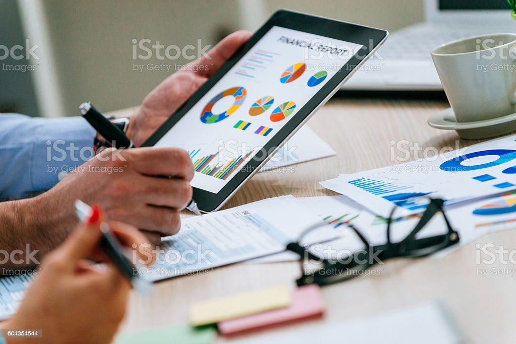 Financial advisors analyze markets stock photo