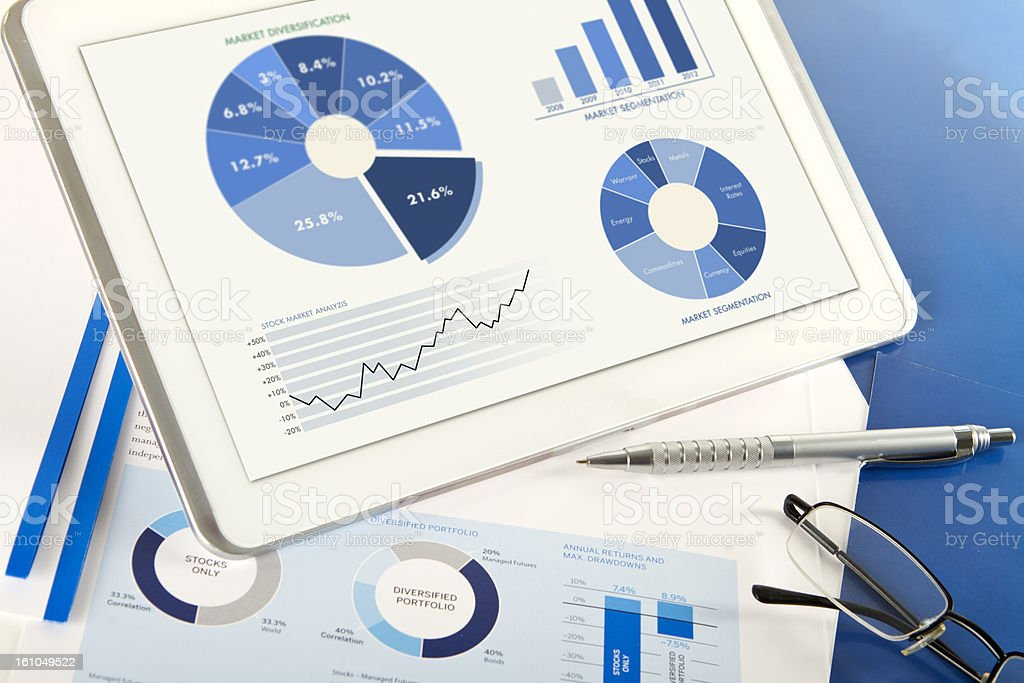 Financial analysis comparison with digital tablet royalty-free stock photo