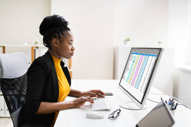 Financial Analyst Using Spreadsheet Software stock photo
