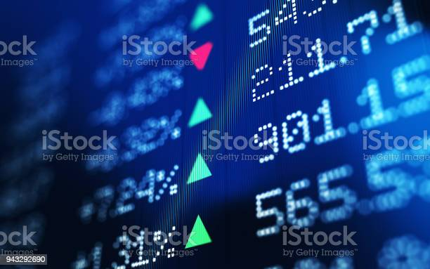Financial data analysis graph showing stock market trends on a trading board. Horizontal composition with copy space and selective focus.