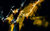 Financial data analysis graph over world map. Horizontal composition with selective focus and copy space.