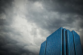 Conceptual Image Of A Financial Building Set Against A Stormy Sky Representing An Economic Crisis