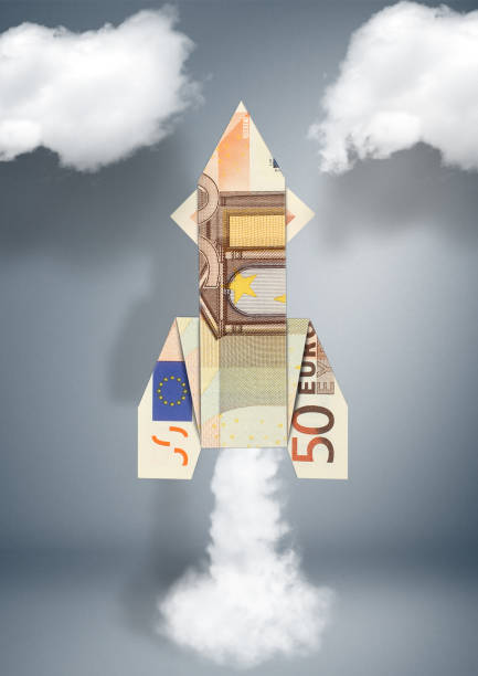 financial business concept, rocket made of money stock photo