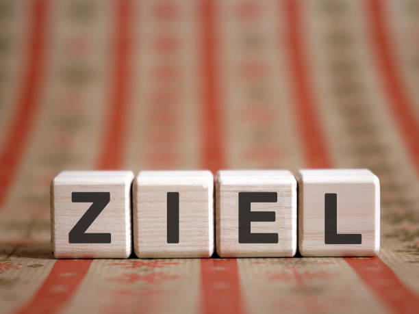 ZIEL - financial business concept. Wooden cubes on a color table. ZIEL - financial business concept. Wooden cubes on a color table. ziel stock pictures, royalty-free photos & images