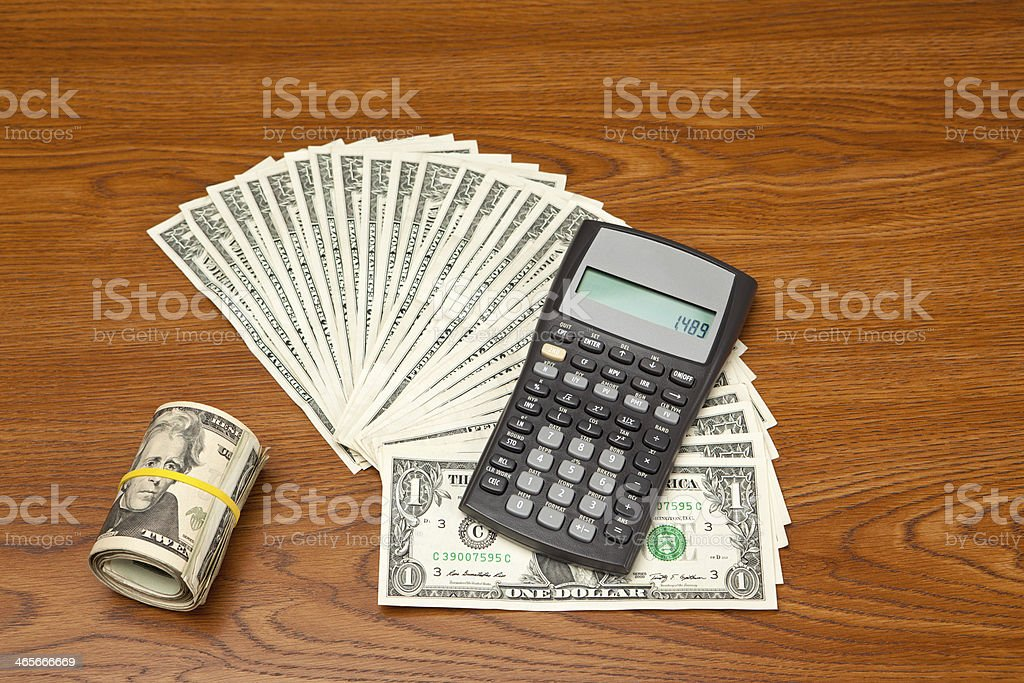Financial Calculator and Money royalty-free stock photo