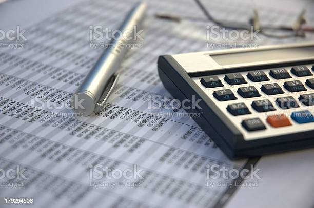 Financial calculator pen reading glasses financial books picture id179294506?b=1&k=6&m=179294506&s=612x612&h=vgmkilbvlzrma0625bxdb7sikltlieqtgu a9ro4gxc=