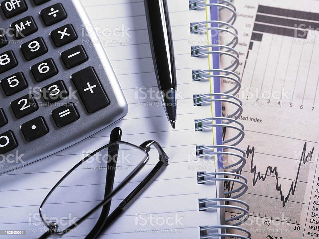 Financial Chart with Glasses And Calculator royalty-free stock photo