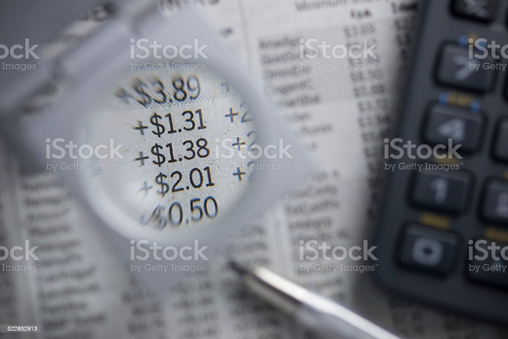 Financial charts. Magnifying numbers. stock photo